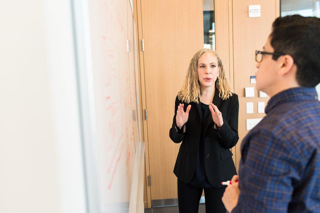 female leader talking with team member